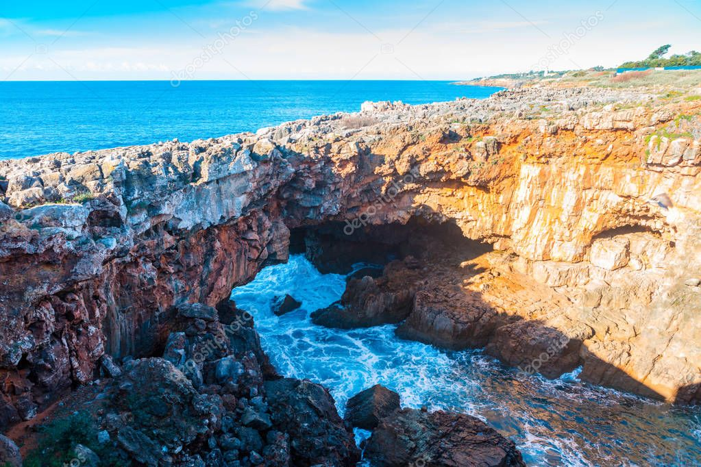 Devils Mouth, Boca do Inferno is a natural phenomenon occurring at the point where a rock formation meets the Atlantic waves in Cascais, Portugal.
