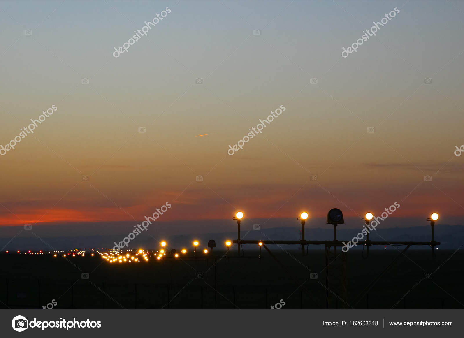 Flight security lights and landing strip in sunsed bakground stock flight security lights and landing strip in sunsed bakground stock photo mozeypictures Image collections