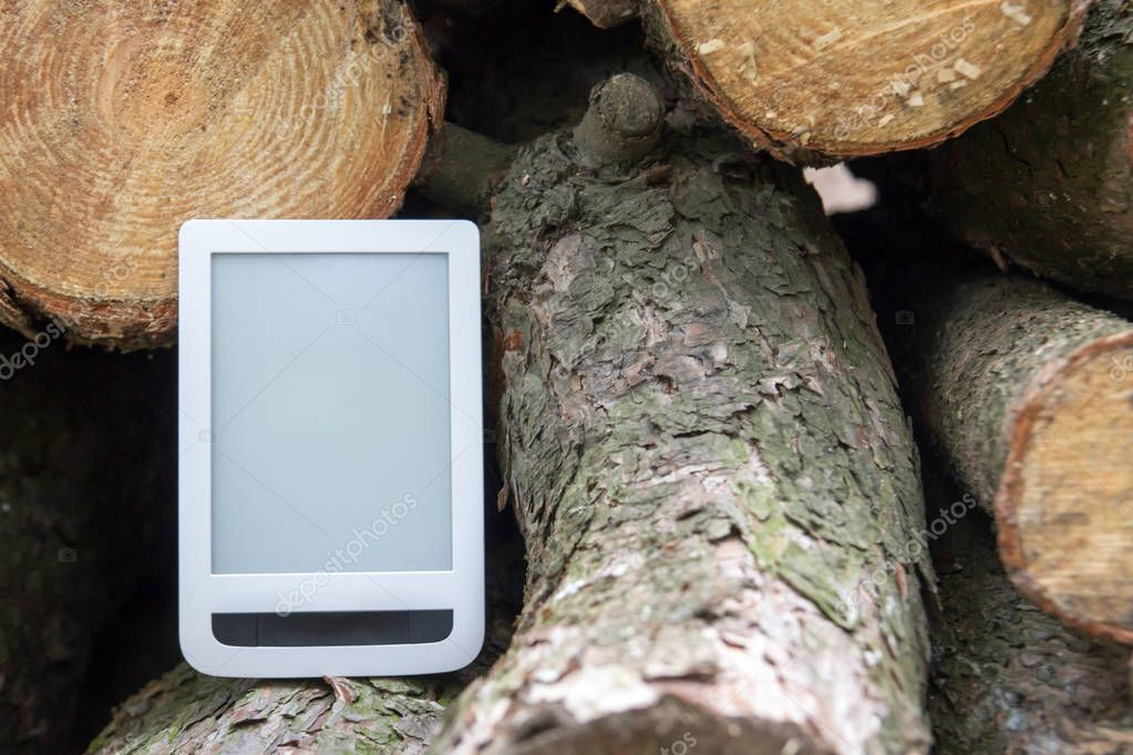 E-book on the background of felled trees, save trees - read eboo