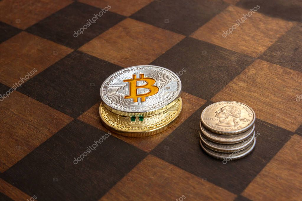 Two Bitcoins and American cents on a chessboard