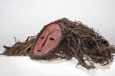 African wooden mask, with hair isolated on white background.