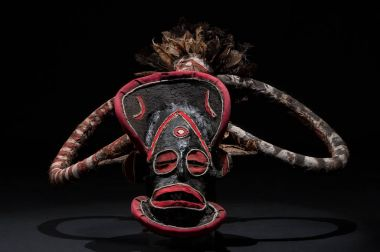 African mask of cloth, traditional, isolated on black background