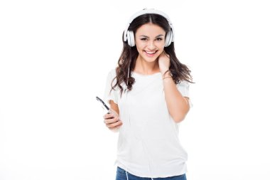 Happy woman in headphones listening to music from smartphone  isolated on white stock vector