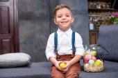 Fotografie Little boy with Easter eggs