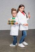 Photo Kids holding test tubes