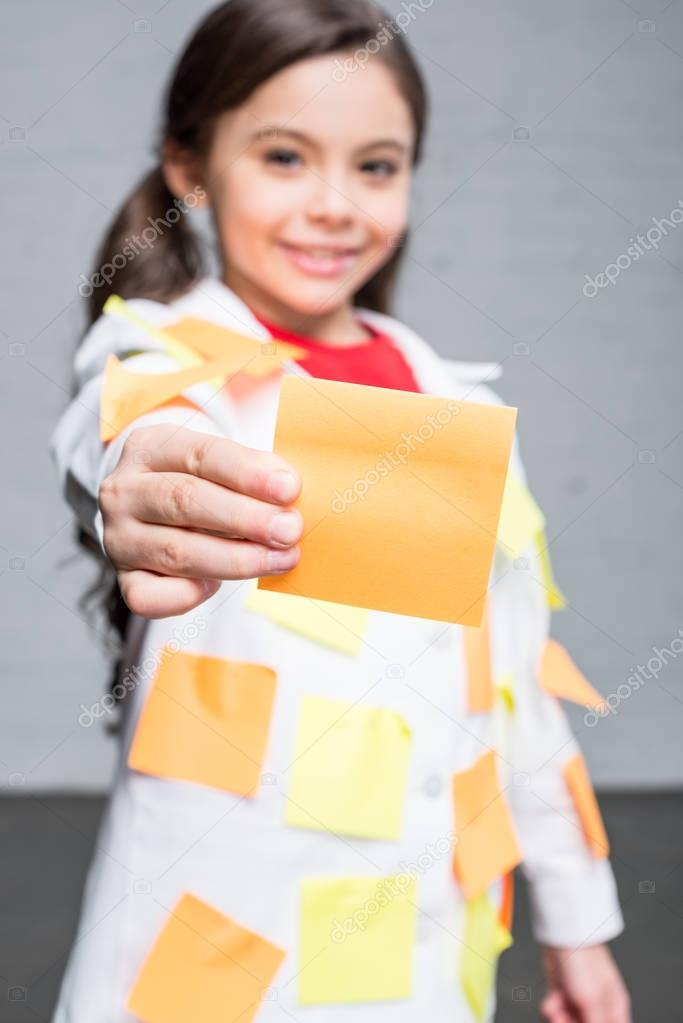 Girl holding sticky note