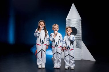 Kids in astronaut costumes