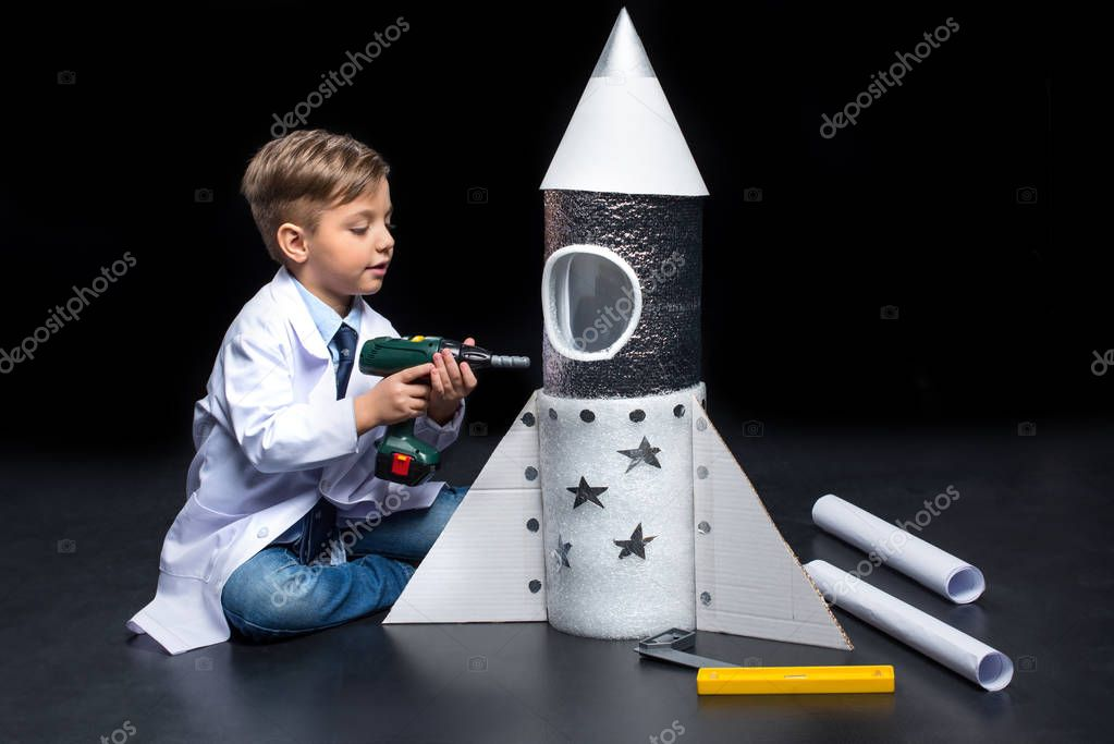 Little boy with rocket