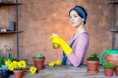 Female gardener with spray bottle