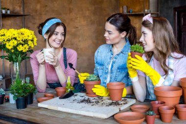 women planting flowers