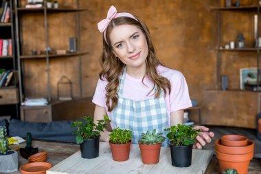 Woman with plants in flowerpots