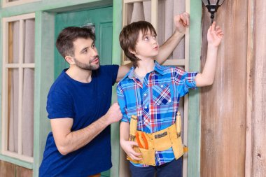 Father and son in tool belt