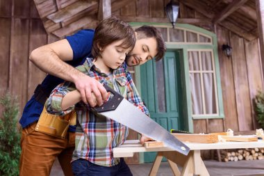 Father and son in workshop