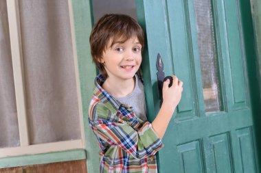 boy standing near door
