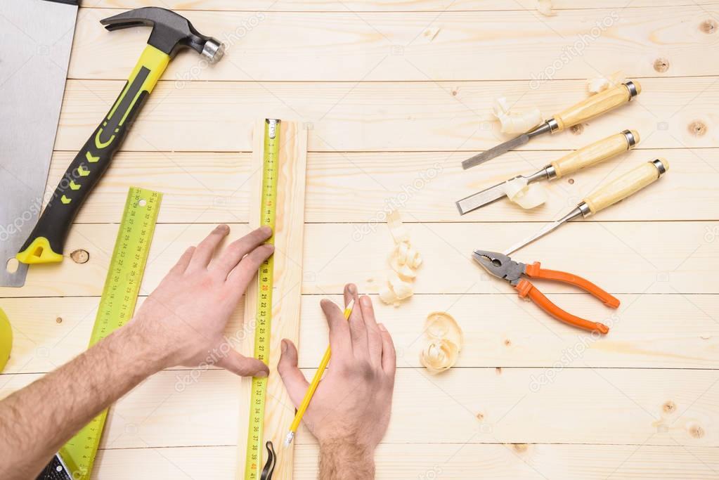 carpenter measuring plank