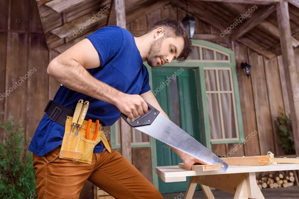carpenter sawing wood