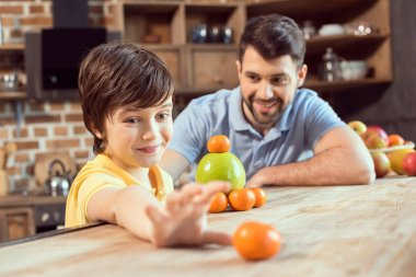 Father and son with fruits