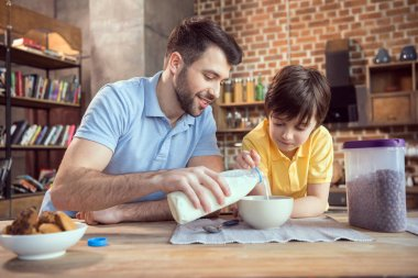 Father and son having breakfast