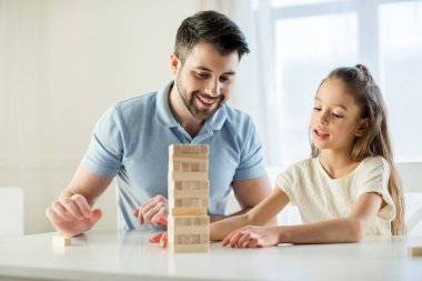family playing jenga game