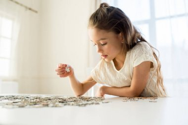 Girl playing with puzzles