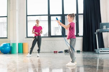 Mother and daughter with skipping rope