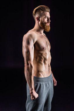 bearded sportsman posing