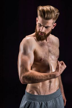 shirtless bodybuilder posing