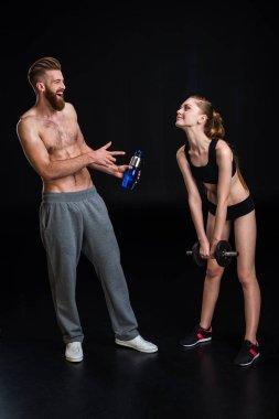 bearded sportsman and sportswoman