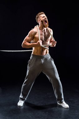 sportsman pulling rope