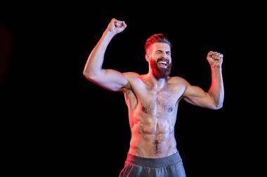 bodybuilder celebrating triumph
