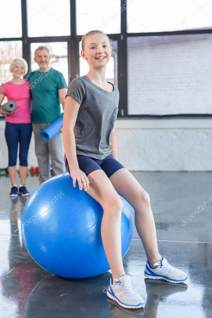 Girl exercising on fitness ball