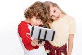 Fotografie Kids taking selfie with smartphone