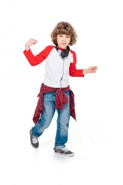 Kid with headphone dancing