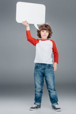 Little boy holding speech bubble