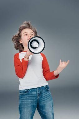 Boy using loudspeaker
