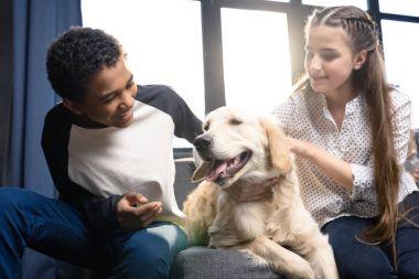Teenage couple with dog