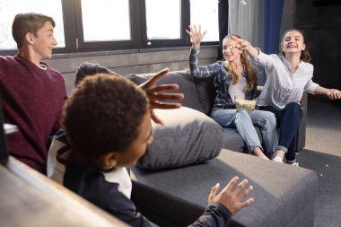 Teenagers having fun with popcorn