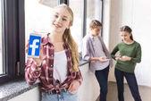 teenage girl showing smartphone