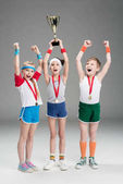 Photo little kids with awards