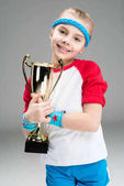 active girl with champions goblet