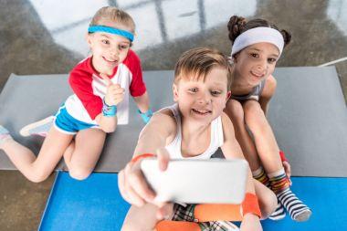 Kids taking selfie
