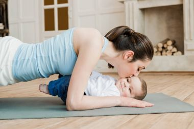 Woman with her son during workout