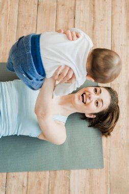 Happy woman playing with her son