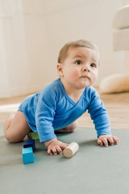 Adorable child playing with toys at home
