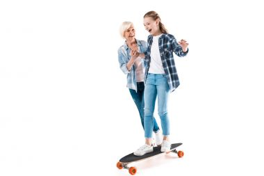 happy granddaughter with skateboard