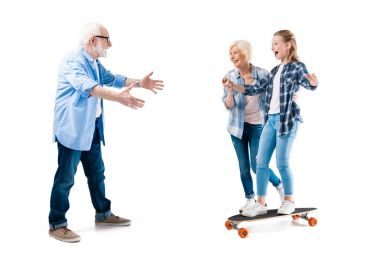 Grandfather, grandmother and happy granddaughter with skateboard isolated on white stock vector