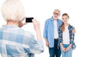 Grandmother taking photo on smartphone