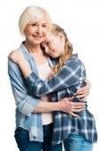 Fotografie Großmutter und Enkelin knuddeln