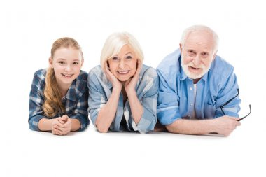 grandfather, grandmother and granddaughter