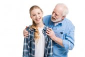 Fotografie Großvater und Enkelin knuddeln